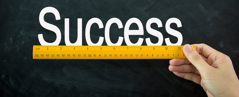 Ruler displayed on blackboard, representing the Definition of Customer Success