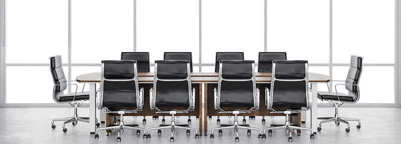 Boardroom table and chairs, representing the Customer SuccessCon Advisors and Faculty