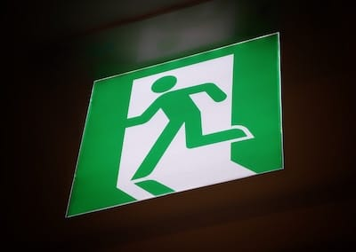 Exit sign - running man in green
