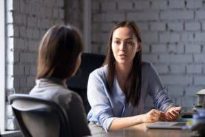 Image of two businesswomen talking