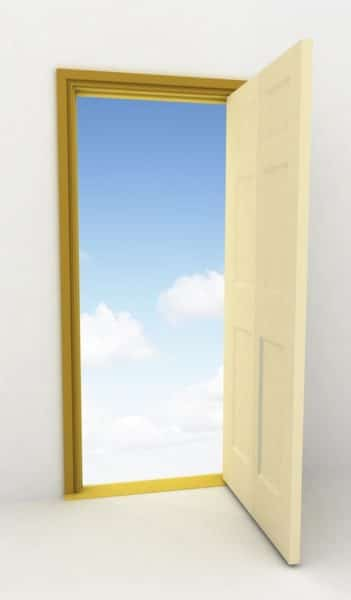 image of open door with blue sky beyond