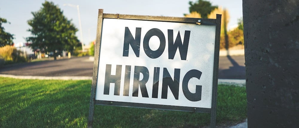 Sign with Now Hiring text