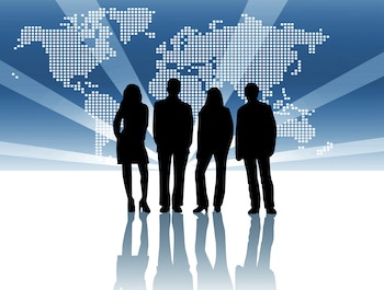 Four business people standing in front of a mercator world projection